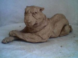 Sculpture de orla: lionne allongee